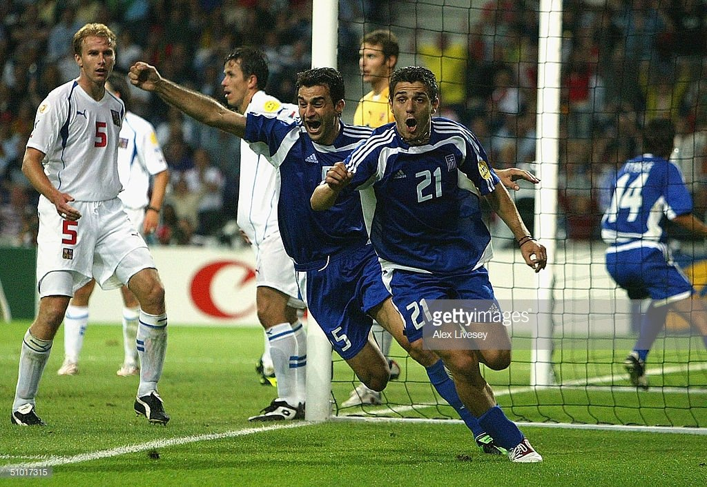 Dellas heads in the infamous silver goal that sent Greece to the final