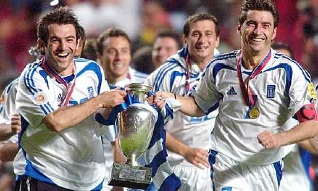 greec trophy Smiles all around from Karagounis and Zagorakis following their triumph